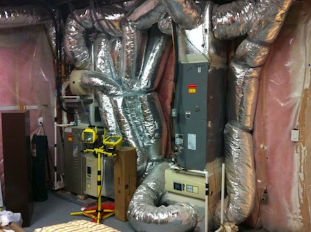 Vapor barrier on a basement wall in a 4 million dollar home (with a ductopus!)