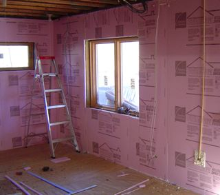 Using building science to transform a damp musty basement - Adding rigid insulation to exterior walls ...