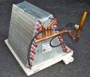 The evaporator coil absorbs heat from the house in the refrigeration cycle.