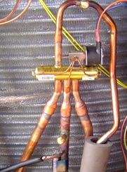 3 ways to tell if that contraption is a heat pump or an ac go outside and peer hvac heat pump reversing valve