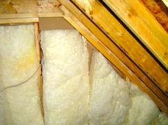 Attic kneewalls insulated with fiberglass batts create problems in many homes.