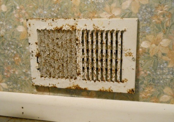 A supply vent that's gotten rusty from years of condensation in an unventilated bathroom