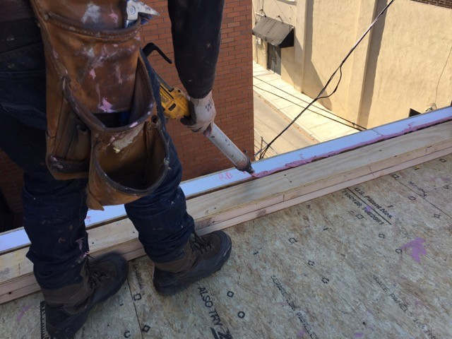 Air sealing the Build SMART wall panels with a sausage gun