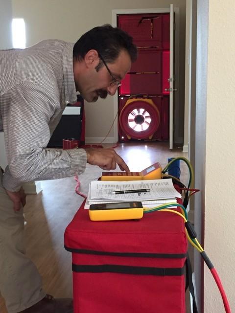 Blower door testing for energy code compliance