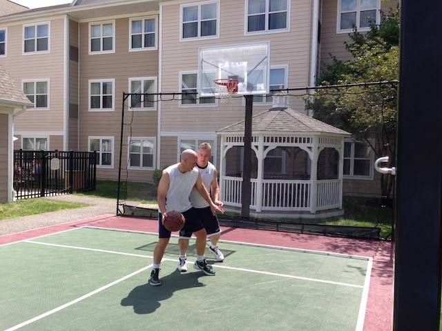 Colin and Randy playing their annual one-on-one basketball match in 2013