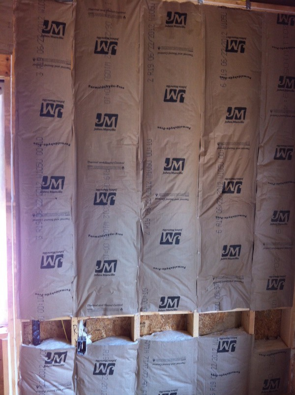 Grade III installation of fiberglass batt insulation with a kraft paper facing