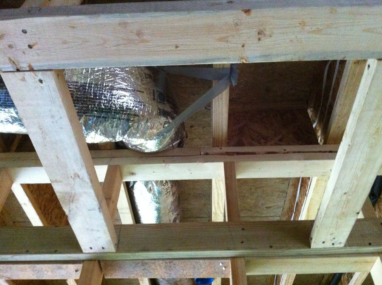 Garage ceiling joists with no blocking and with ducts running through