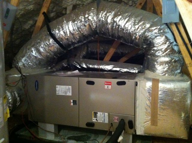 A large bypass duct sending some conditioned air directly back to the return side of the air handler