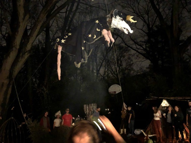 The Sorcerer Possum hangs above the fire at the 2019 Possum Drop party