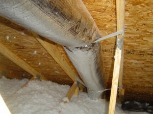 Duct against the roof deck in an unconditioned attic