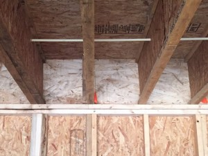 Garage ceiling joists that terminate at a good air barrier