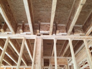 A difficult air sealing task with garage ceiling joists