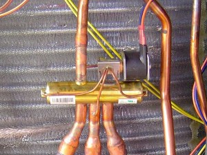 A heat pump is an air conditioner with a reversing valve