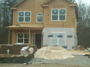 Installing windows before house wrap is like tucking your raincoat into your pants.