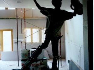 drywall-finisher-on-stilts.jpg