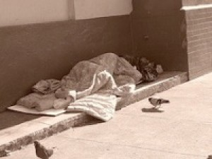 mad housers homeless person sleeping on street