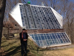 What exactly is a low-load home?  (Architect Richard Levine stands in front of the low-load, solar home he designed and built in the 1970s. Photo by Energy Vanguard)