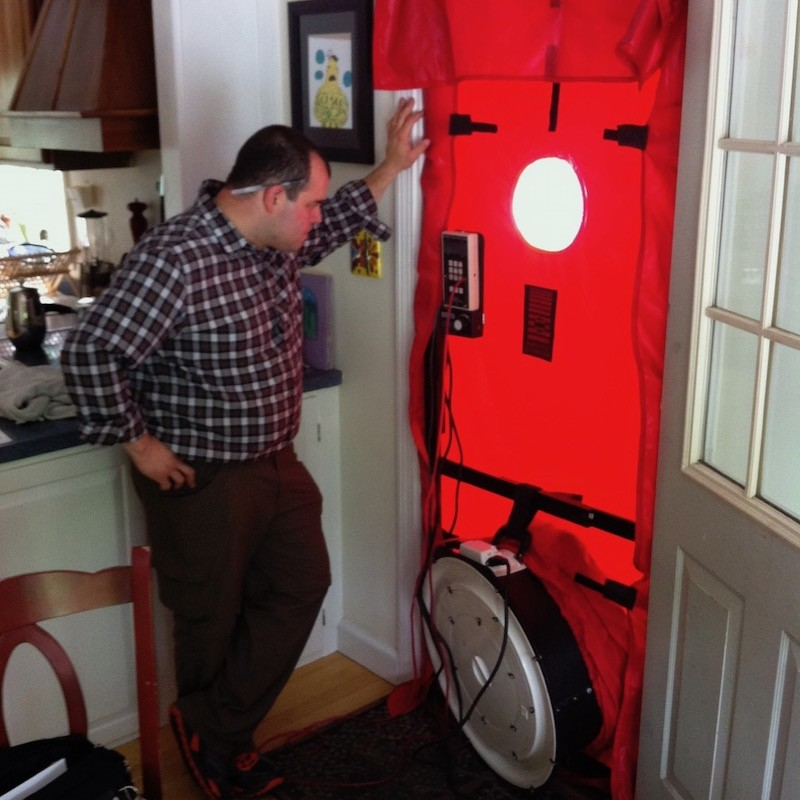 Blower door testing to determine a home's air leakage rate