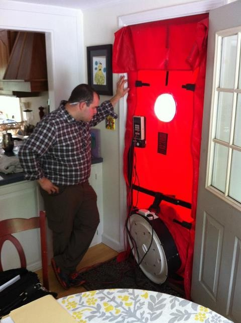 Blower door test during a home peformance assessment