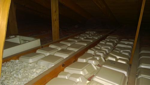 Installing Rolls Of Fibergl Insulation In An Attic