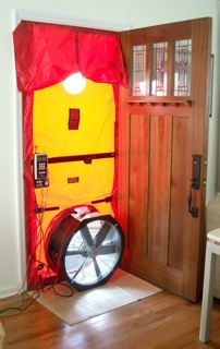 blower door test for air leakage infiltration building envelope