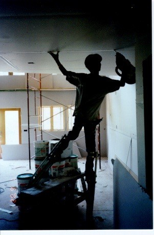 drywall-finisher-on-stilts.jpg