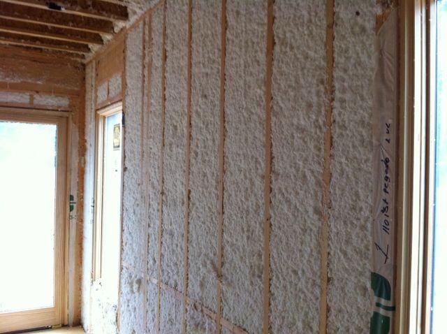A 2x4 wall with blown fiberglass insulation