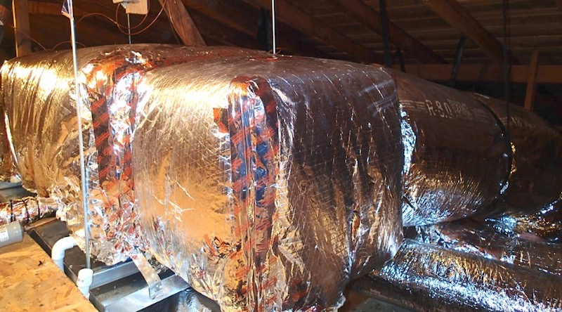 Air handler and plenums well insulated in an unconditioned attic [Photo by Mike MacFarland, used with permission]