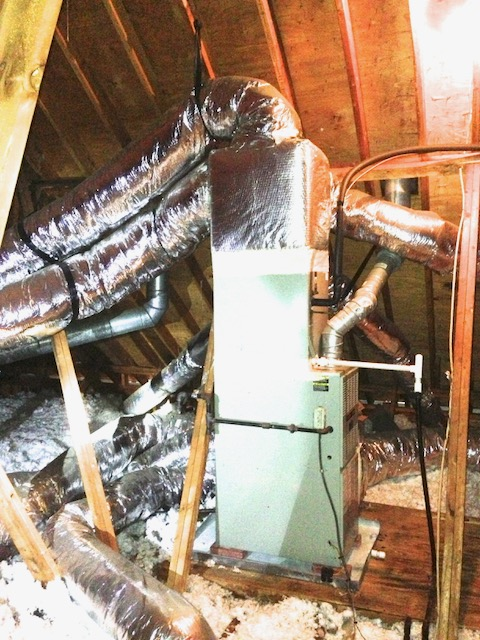 Air handler in an unconditioned attic installed vertically